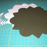 Cut out background applique laid out with paper patterns