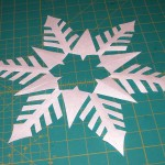 Cut out freezer paper pattern for snowflake