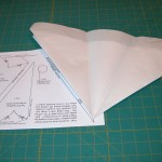 Aligning folded triangle on top of pattern template drawing