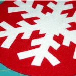 Close up of the single layer white snowflake applique fused to background