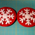 Two sample models with appliques stitching completed
