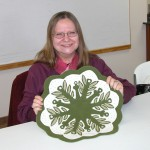 A smiling Linda with her  Leaf Snowflake #3 topper