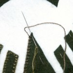 The 'tip' stitch - note the needle is OVER the thread