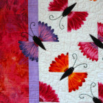 A closer look at the flower butterflies - even one flying off the quilt!