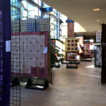 Another main hallway of quilts - the lighting was wonderful!