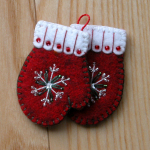 One pair of brightly colored mittens - stitched and beaded!