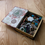 'Book box' shown open and holding ornaments - should I line this with felt???