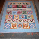Row Quilt finished with hand quilting while waiting for 'George'