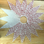 partially done center star for Christmas tree skirt